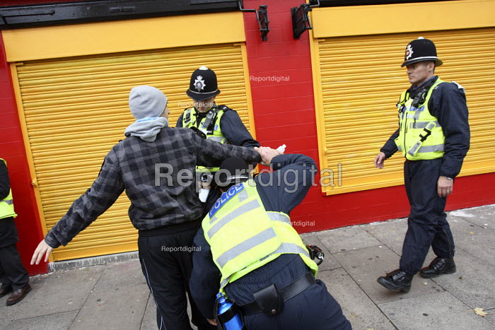 Police stop and search a young man ahead of an English... - Justin Tallis, JT1010121.JPG