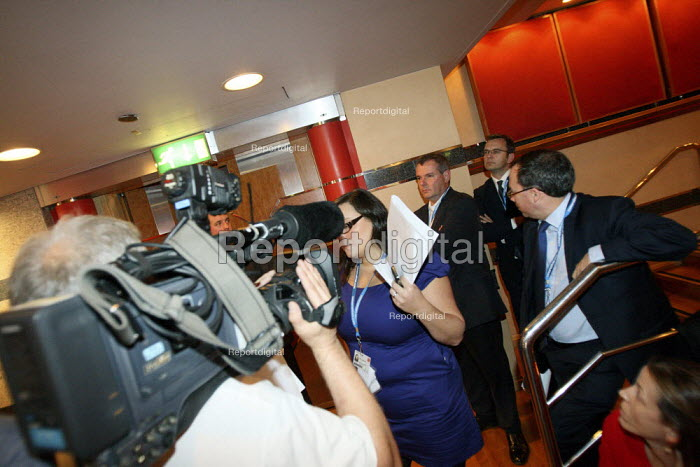 Minders try to prevent a BBC cameraman filming Andy Coulson Communications Director in the audience listening to David Camerons leaders speech at the 2010 Conservative Party Conference, Birmingham. - Justin Tallis - 2010-10-06