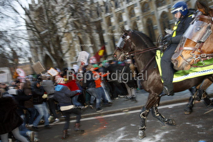 Police horses charge protesters contained in Parliament Square. Demonstration against plans to raise tuition fees and cuts in university funding. London. - Justin Tallis - 2010-12-09