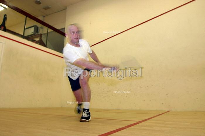 Sportsman playing a game of squash - Justin Tallis - 2004-12-29