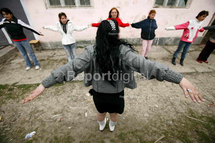Roma gypsy children exercising in the street, outside their community centre. - Justin Tallis - 2007-03-17