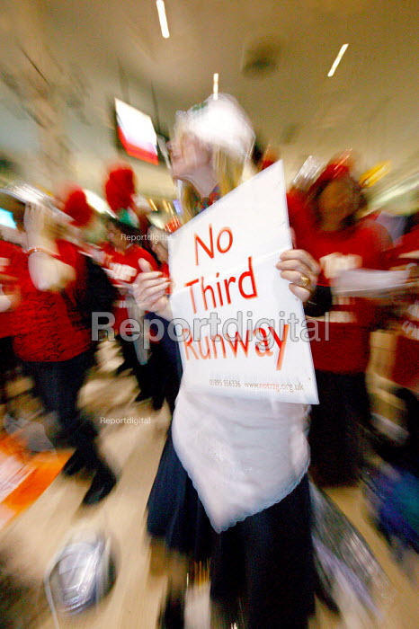 Eurovision Flash Mob protest at Heathrow Terminal One. Europe-wide Flash Mob taking place on the same day at 6 airports across Europe. London Heathrow Airport. - Justin Tallis - 2009-05-16