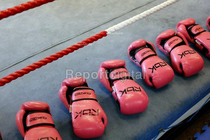Pink boxing gloves. Times ABC Boxing Club. Islington, London. - Justin Tallis - 2009-08-27