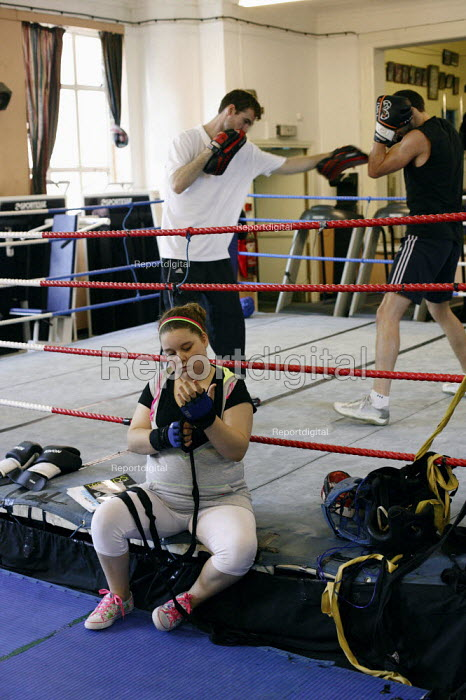 A young girl strapping up her hands to box. Times ABC Boxing Club. Islington, London - Justin Tallis - 2009-08-27