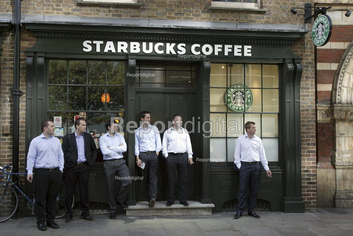 City workers standing outside Starbucks Coffee shop on their lunch break. City of London. - Justin Tallis - 2009-09-01