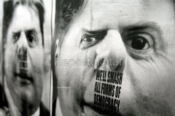 Anti BNP posters give Griffin a Hitler moustache, Questioning Question Time emergency public rally. UAF host a public meeting challenging the BBC's decision to invite BNP leader Nick Griffin onto the BBC Question Time programme. Conway Hall, London. - Justin Tallis - 2009-10-21