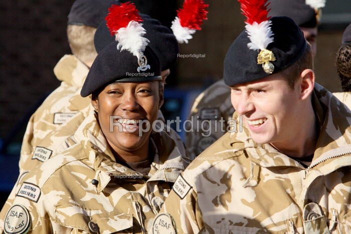 At ease having a laugh. Soldiers of the Second Battalion, the Royal Regiment of Fusiliers before they march through the streets after they have been granted the Freedom of the Borough. The regiment has recently returning from a tour of duty in Afghanistan. Hounslow, London. - Justin Tallis - 2009-11-26
