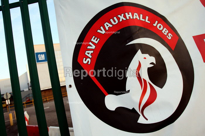 """A Union banner saying """"Save Vauxhall Jobs"""" hangs over the fence in front of General Motors Manufacturing Plant in Luton. - Justin Tallis - 2009-12-01"""