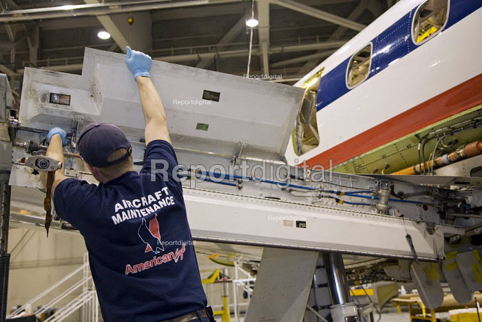 Gwinn, Michigan - Workers do heavy maintenance on Embraer aircraft flown by American Eagle, the regional affiliate of American Airlines, at Sawyer International Airport. - Jim West - 2007-11-06