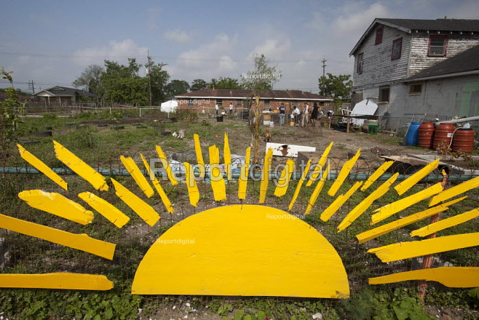 New Orleans, Louisiana - Symbol of sunshine at the entrance to a community garden in the lower ninth ward. The garden will turn vacant lots devastated by Hurricane Katrina into an urban farm that will provide learning opportunities for area youth and fresh produce for the neighborhood. - Jim West - 2009-04-05
