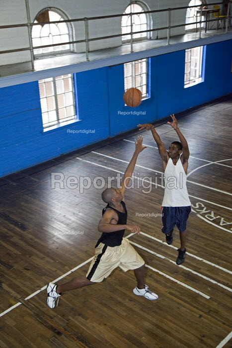 Boys play basketball in an After School Program at North Rampart Community Center (NRCC), USA. - Jim West - 2009-03-25