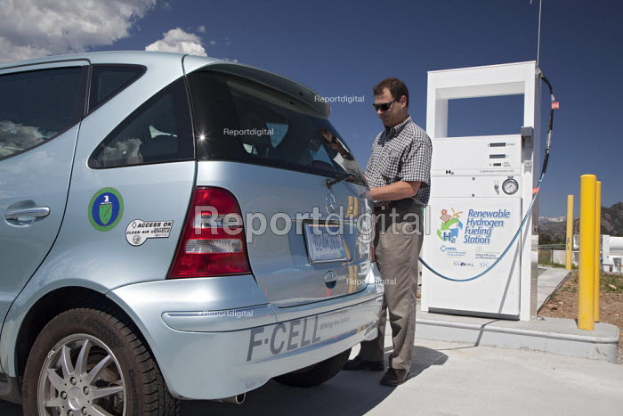 A man fuels a hydrogen powered fuel cell vehicle at the National Renewable Energy Laboratorys Wind Technology Center. One of the Centers projects involves using electricity from wind turbines to produce hydrogen, which can be stored and used later in fuel cells or burned to make electricity, USA. - Jim West - 2009-07-07