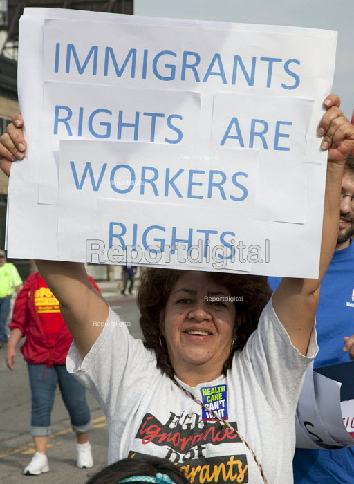 Detroit, Michigan - AFL-CIO Union members and immigration reform activists march in the Labor Day parade. Immigrants rights are workers rights - Jim West - 2009-09-07