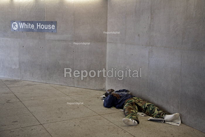 Washington, DC - A homeless man sleeps at the entrance to a Metro subway station near the White House. - Jim West - 2009-09-18