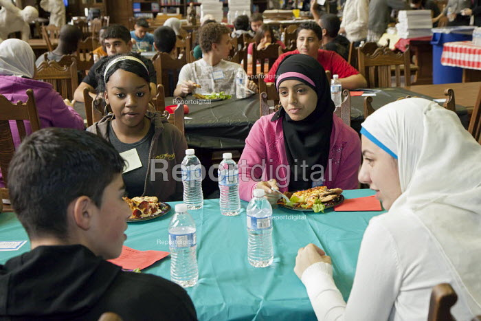 Dearborn, Michigan - Students from diverse backgrounds get to know each other at lunch hour on Mix It Up Day at Fordaon High School. Mix It Up Day is a national program which encourages students to associate with others of diverse ethnicity and cultures who they might not normally come in contact with. - Jim West - 2009-11-10