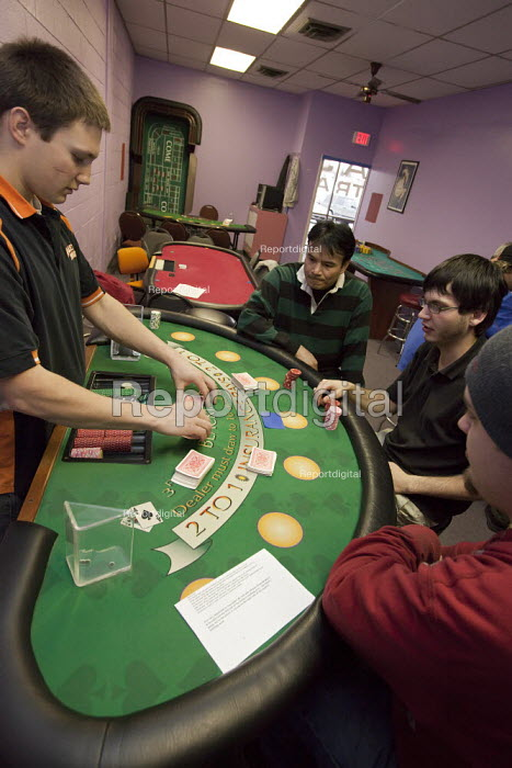 Students practice working as casino card dealers at the ABC School of Bartending and Casino College. - Jim West - 2010-01-04