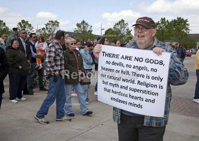 A man carries a sign denouncing religion, during a National Day of Prayer observance at City Hall. - Jim West - 2010-05-06