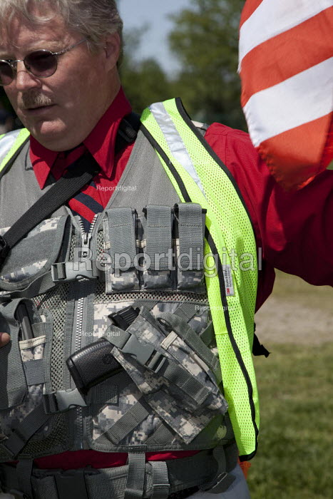 Pro-gun activists rally across the Potomac River from Washington, DC, the closest they could get to the nation's capitol while legally and openly carrying firearms. They are the first people to rally with firearms in a national park. - Jim West - 2010-04-19