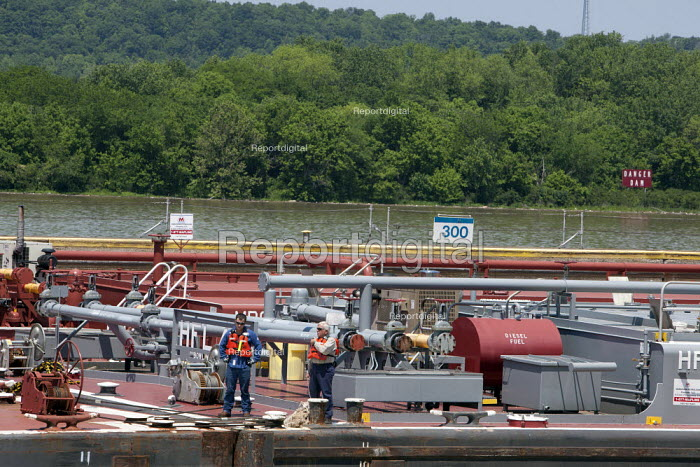 Crewmen keep watch on a Marathon Oil Company barge as it enters a lock at the Markland Dam, on the Ohio River. - Jim West - 2010-05-23