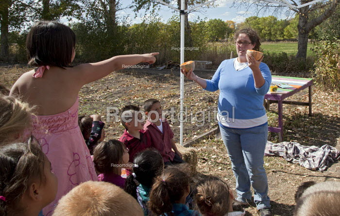 Americorps volunteer talks to elementary school children at the Polston Community Garden in Colorado's San Luis Valley about where food comes from. USA - Jim West - 2010-10-07
