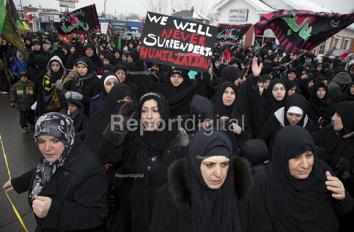 Shia Muslims process through the streets of Dearborn to commemorate Arbaeen, a holiday marking the martyrdom of Muhammads grandson, Hussein ibn Ali, in the Battle of Karbala in 680 CE. Michigan, USA. - Jim West - 2012-01-14