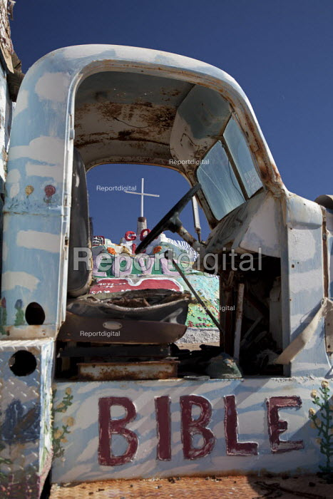 An old truck painted with religious slogans at Salvation Mountain, a desert hillside covered with religious messages, created by Leonard Knight. USA. - Jim West - 2012-01-28