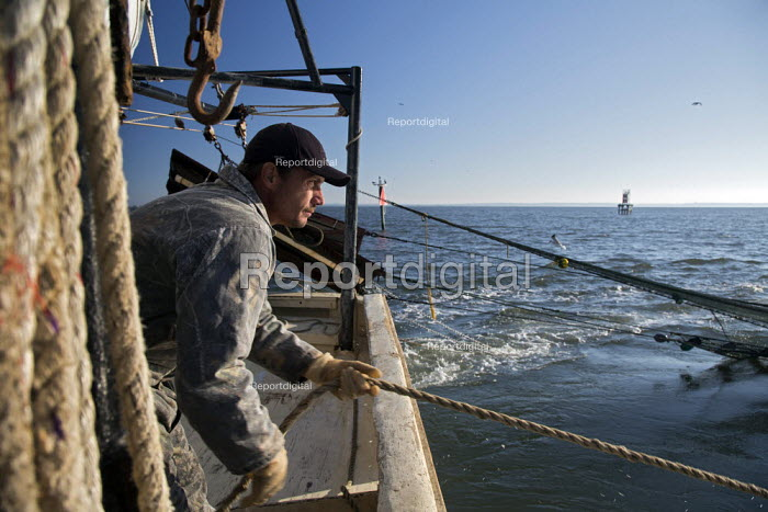 Mobile, Alabama - A shrimp trawler on Mobile Bay. Darrell Goleman brings in the trawl net. The trawler is part of the Alabama Fisheries Cooperative. - Jim West - 2012-11-08