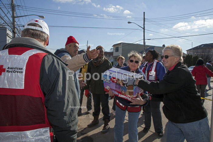 New York, New York - Volunteers on Staten Island help with the recovery from Hurricane Sandy, unloading supplies on a street corner for neighborhood residents who lost their belongings in the storm. - Jim West - 2012-11-28