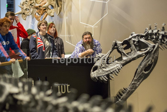 Salt Lake City, Utah - The Natural History Museum of Utah at the Rio Tinto Center on the University of Utah campus. A guide talks to visitors about the dinosaurs in the museum's Past Worlds exhibit. - Jim West - 2014-11-15