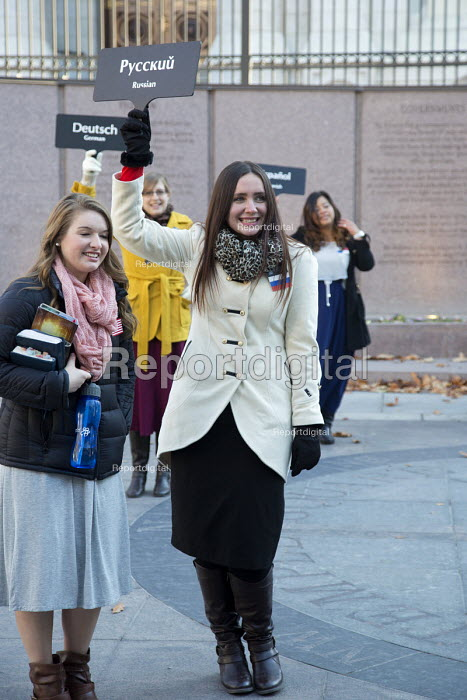 Salt Lake City, Utah - Sister missionaries holding signs to indicate what languages they speak, Foreign language speakers offer to guide tourists around the church's Temple Square complex. - Jim West - 2014-11-16