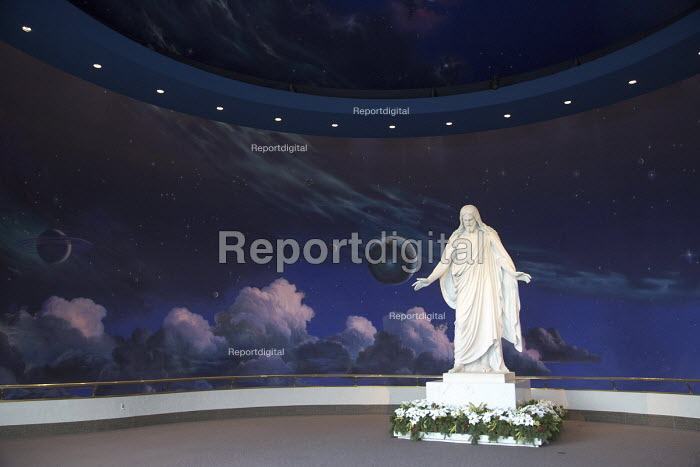 Salt Lake City, Utah - A statue of Jesus Christ in a Mormon visitor center in Temple Square, a replica of the Christus, a statue of Jesus Christ by Danish sculptor Bertel Thorvaldsen. With clouds, stars, planets, and other heavenly bodies - Jim West - 2014-11-14