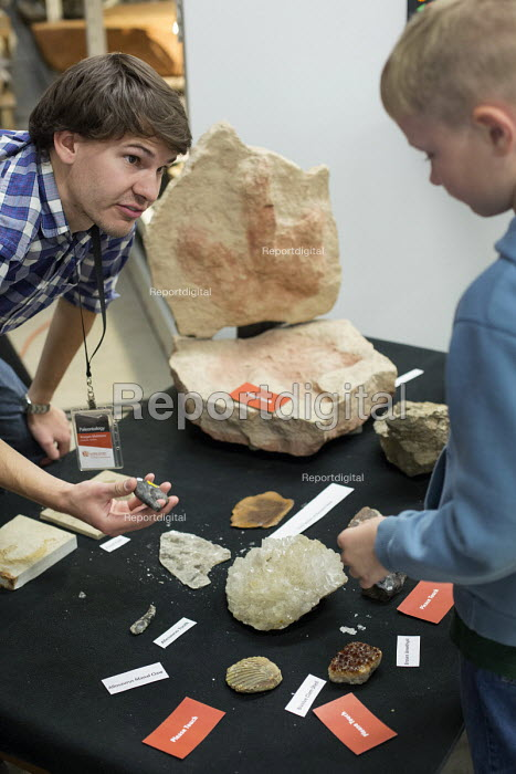 Salt Lake City, Utah - The Natural History Museum of Utah at the Rio Tinto Center on the University of Utah campus. A worker shows children rocks and fossils from the museum's collection. - Jim West - 2014-11-15
