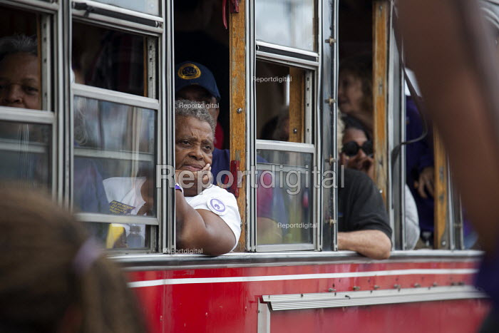 Detroit, Michigan - Passengers on a vintage trolley car watch the May Day parade. - Jim West - 2013-09-02