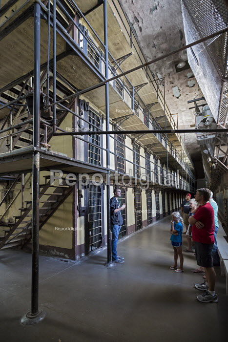 Group tour Wyoming Frontier Prison USA the former State Penitentiary closed in 1981 after housing 13,500 inmates in its 80 years of operation - Jim West - 2015-07-13