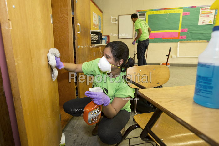 Detroit, Michigan Volunteers from Life Remodeled, a nonprofit organization, clean and renovate classrooms at Osborn High School in an effort to improve the neighborhood. - Jim West - 2015-08-04