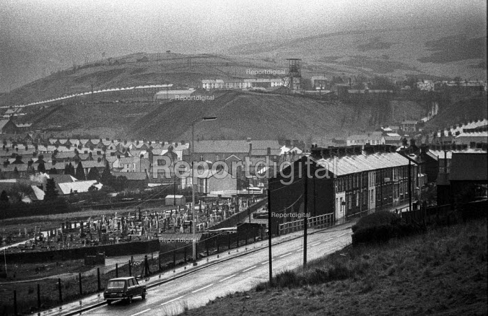 Nantymoel pit village, Ogmore Vale, South Wales, overshadowed by the pit head and slag heap, during 1972 miners strike - Martin Mayer - 1972-01-15