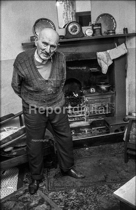 Retired miner Charles Clark, 90, in the living room of last inhabited cottage in row of old National Coal Board cottages, Blackwood South Wales. He had lived there since 1914 and had taken part in the 1926 General Strike - Martin Mayer - 1972-01-15
