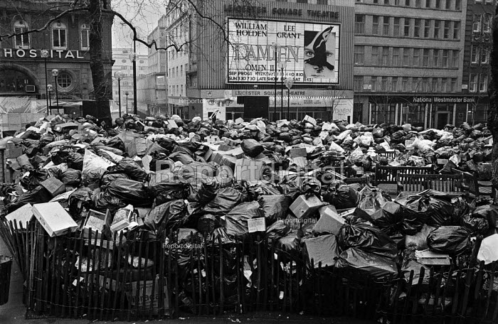 Rubbish piling up in Leicester Square, central London as decided by Westminster City Council as refuse collectors strike for a pay rise during The Winter of Discontent. Horror film Damien - Omen II opens at the Leicester Square Theatre, London - Martin Mayer - 1979-02-13