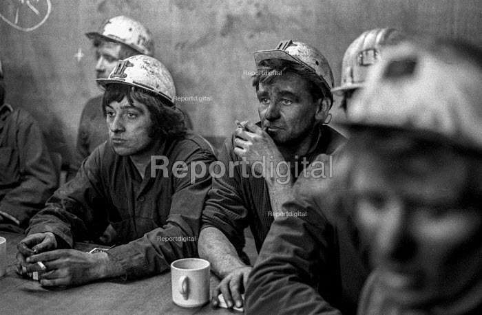 Exhausted members of a rescue team at Lofthouse colliery, West Yorkshire, giving details of pregress in rescuing their fellow miners during the pit disaster that claimed 7 lives 1973 - Martin Mayer - 1973-03-21