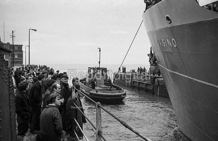 The Orsino sets sail from Hull docks for Iceland, the first experimental mothership for the trawler fleet, watched by seamen and dockers - Martin Mayer - 1968-10-29