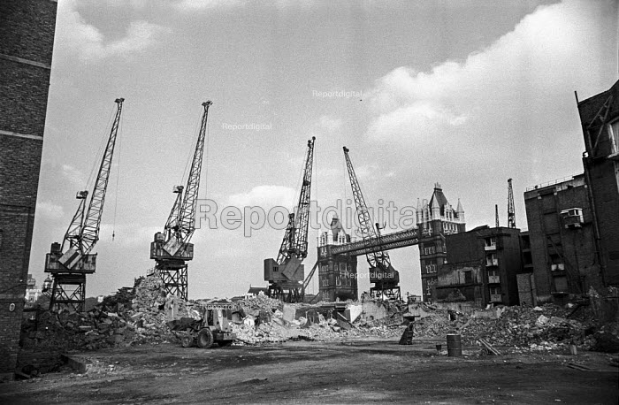 Cranes still standing as wharves near Tower Bridge are demolished on site of current London City Hall as containerisation begins downstream - Martin Mayer - 1987-10-06