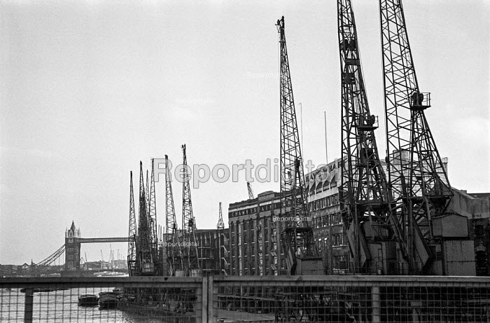Cranes still standing outside Hays Wharf and Chamberlains Wharf, which escape the wrecking ball as other wharves near Tower Bridge are demolished during the closure of London wharves and docks as containerisation gets established downstream - Martin Mayer - 1987-10-06