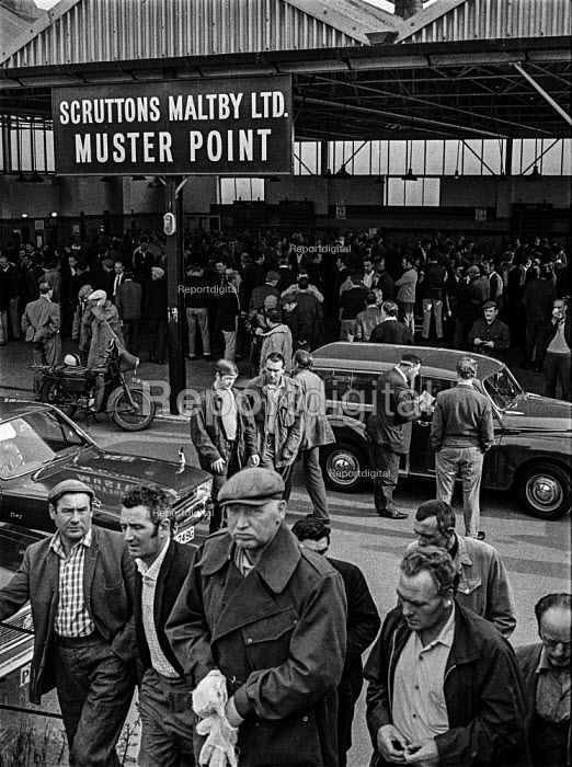 Dockers gather at one of the muster points (formerly known as pens) in the East India docks, London, waiting to be picked for work just before containerisation led to the closure of the old docks. Dock work was still semi casual and work was never guaranteed on any one day. - Martin Mayer - 1970-07-06