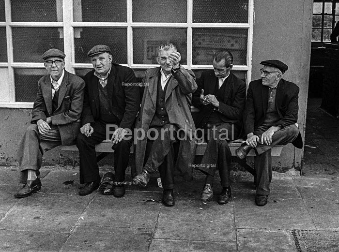 Older dockers, who failed to get work for the day, East India dock, London, as containerisation is about to destroy their jobs for good. - Martin Mayer - 1970-07-06
