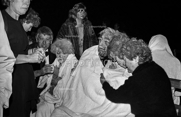 Shocked and bloodied delegates to the Conservative Party conference outside The Grand Hotel, Brighton, after the IRA exploded a bomb in an attempt to assassinate Margaret Thatcher. - Martin Mayer - 1984-10-12