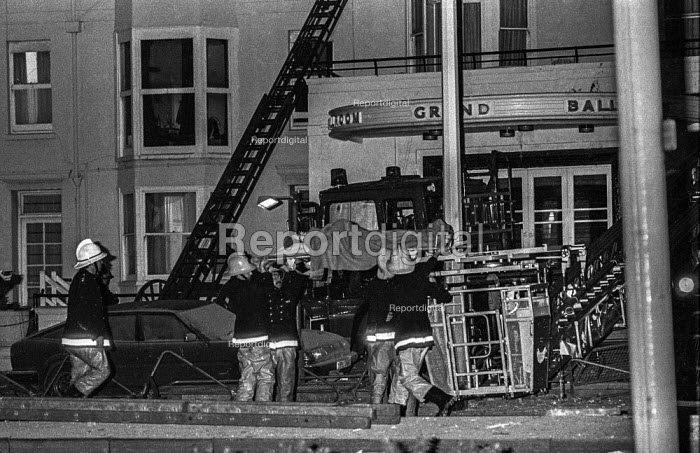 Firemen rescue an injured guest at the Grand Hotel, Brighton, in the aftermath of the bomb attack in which the IRA attampted to assassinate Prime Minister Matgaret Thatcher - Martin Mayer - 1984-10-12