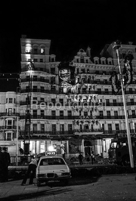 Police and firemen outside the heavily damaged Grand Hotel, Brighton, just after the bomb attack in which the IRA attempted to assassinate Prime Minister Margaret Thatcher - Martin Mayer - 1984-10-12