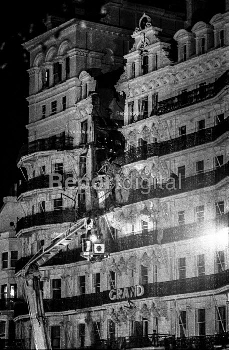 Firemen check for injured guests at the heavily damaged Grand Hotel, Brighton, in the aftermath of the bomb attack in which the IRA attempted to assassinate Prime Minister Margaret Thatcher - Martin Mayer - 1984-02-20
