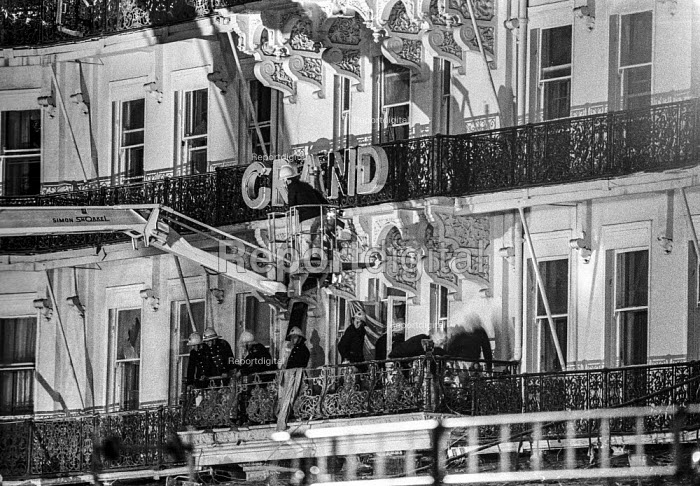 Firemen check for injured guests at the Grand Hotel, Brighton, in the aftermath of the bomb attack in which the IRA attempted to assassinate Prime Minister Margaret Thatcher - Martin Mayer - 1984-10-12