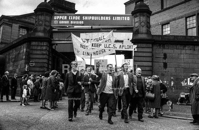 Shipyard workers march out of Upper Clyde Shipyards, Glasgow to join a march of 80,000 trades union members opposing the threatened closure of the yards. They later occupied the yards in a 'work-in', which saved some of the yards for a while. - Martin Mayer - 1971-06-23